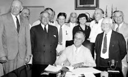 FDR signs Social Security into law.