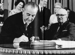 President Lyndon Johnson signs Medicare into law in 1965.
