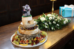 This cheese-y wedding featured a variety of cheese, some of them hard to obtain, layered into a wedding cake topped by mice.