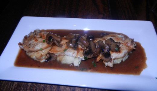 Pollo Oloroso: Grilled chicken breast with Oloroso sherry mushroom sauce and manchego cheese mashed potatoes