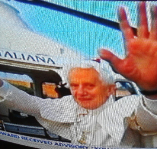 Former Pope Benedict XVI waves goodbye.