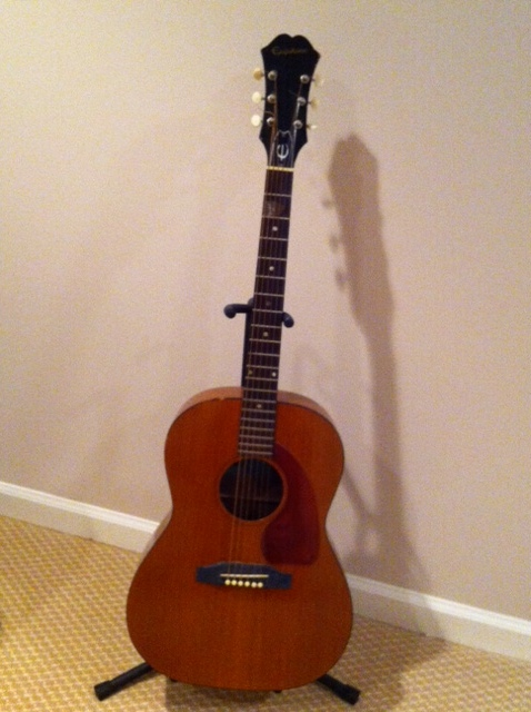 A beginner guitar with thin neck and small body.