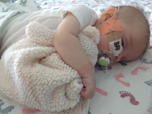 Sleeping with his snuggle-bear.