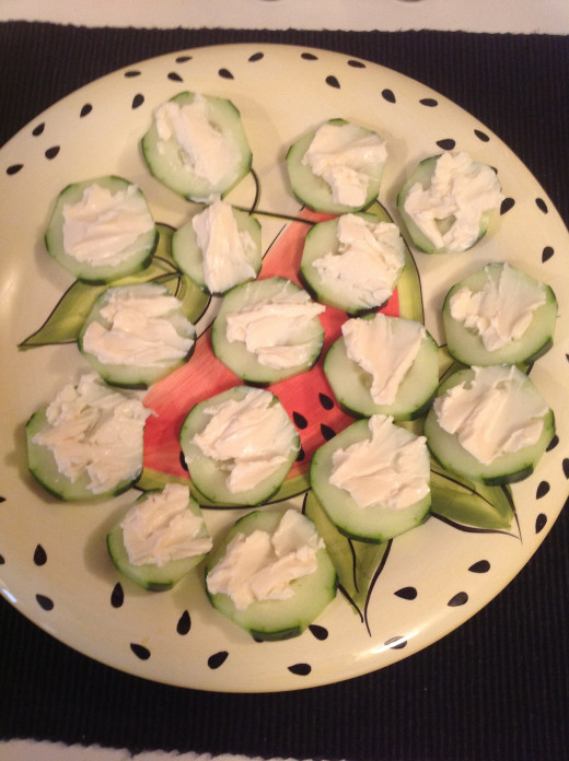 Spread cheese onto the cucumber slices