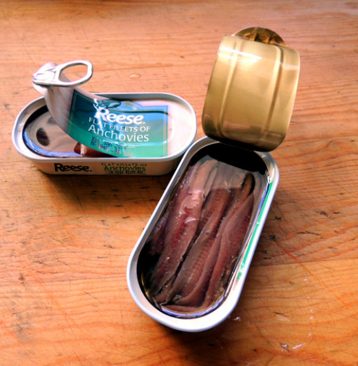 drain anchovies, but reserve oil