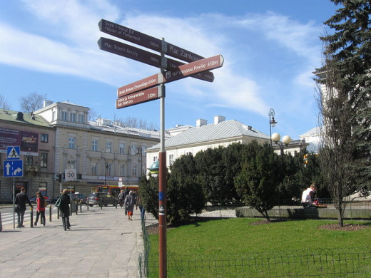 Signposts in Warsaw--perhaps some of the Conference attendees will pass this way; we could wish our ways were charted as clearly.  Image courtesy Foledman and Wikimedia Commons.