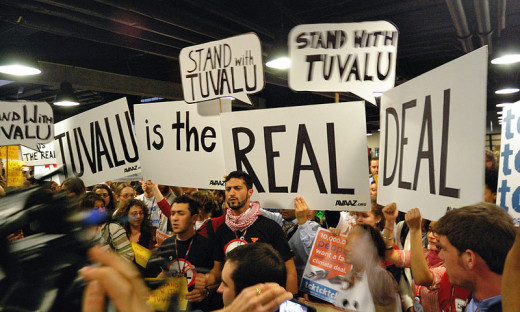Demonstration for Tuvalu, a Pacific island nation at risk of inundation in warming climate, at the 15th COP, Copenhagen.  Image courtesy photographer Lauri Myllyvirta and Wikimedia Commons.
