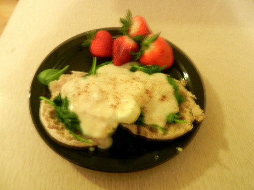 Eggs Florentine with the cheese sauce spooned over the egg.