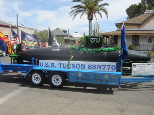 Model of USS Tucson SSN-770 Attack Submarine being driven through El Presidio Historic District in Tucson's Annual St. Patrick's Day Parade