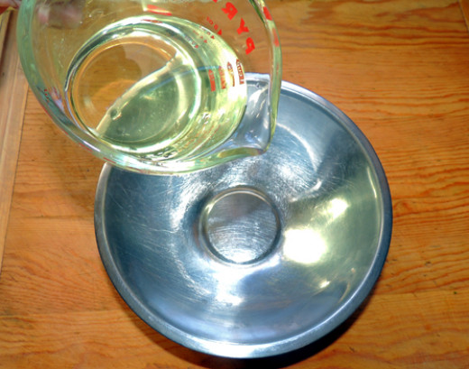 pour oil in a mixing bowl