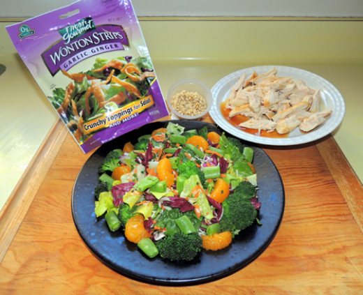 now add: broccoli, snap peas, & mandarin orange slices. Top with crunchy wontons, nuts & chicken shreds