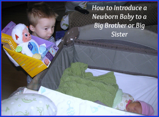 Introducing a little sister to her big brother.