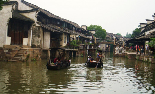 This town is constructed of narrow alleys, riverways, houses on stilts, residents cooking lunch, and tourists.