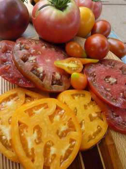 Sliced Pineapple and Paul Robeson heirloom tomatoes have that  rich, old fashioned tomato flavor.