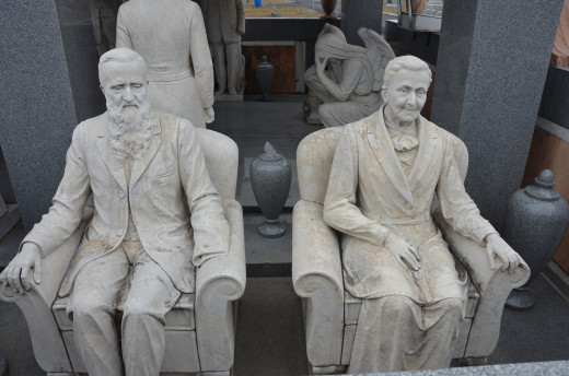 John and Sarah Davis sculpted in their later years.