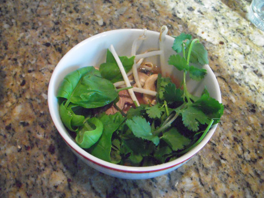 This shortcut pho is made with packaged broth and quinoa. It is garnished with cilantro, basil and sprouts. I did not have Thai basil and used regular Italian basil instead. Cooked quinoa is hiding at the bottom of the bowl.