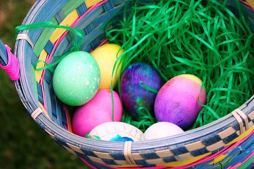 Colored eggs in basket
