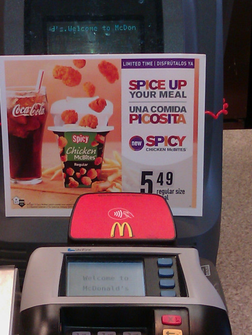 Bilingual signs are cropping up at national brands throughout the U.S.