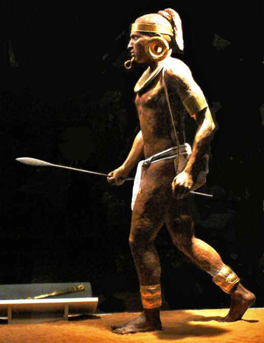 Full-size indigenous warrior depicted with gold ornamentation and spear typical of those found in Costa Rica.  Gold Museum.