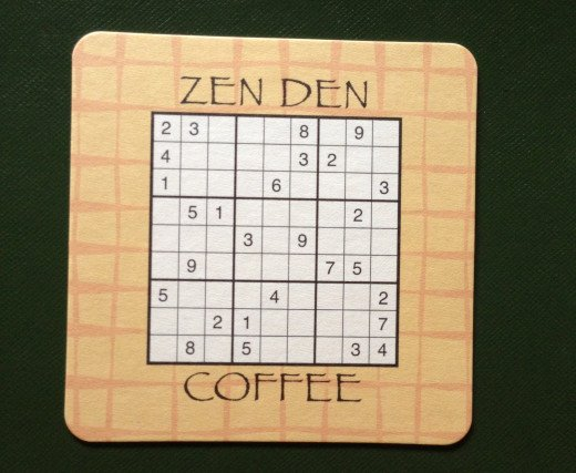 Back of coaster featuring game to entertain restaurant guests.