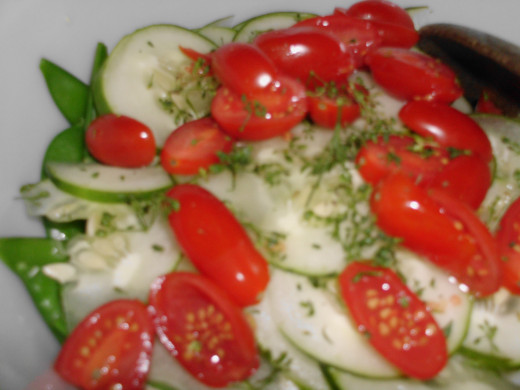 Cucumber, grape tomatoes and smoked salmon pieces salad