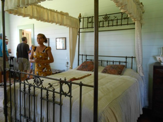 Tour guide in a bedroom of Vailima