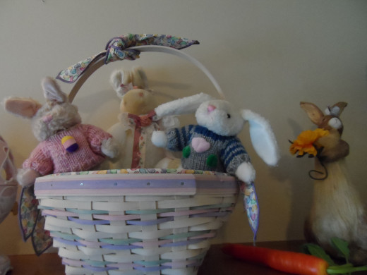 A basket full of bunnies are the focal point on the fireplace mantel
