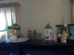 Another shelf top to fill. A butterfly house from the garden and an Easter tree.