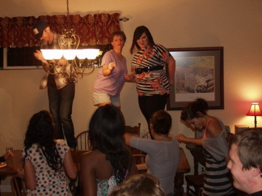 My wife and cast members dancing on our dining room table during a post performance party.  These people are self energizing and don't need ushers.