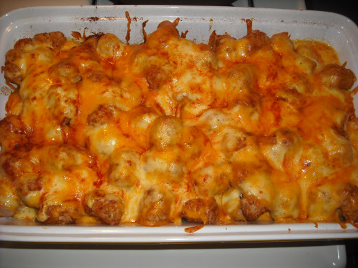 Sausages and tater tots, smothered in cheese