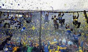 Boca fans climbing the fence