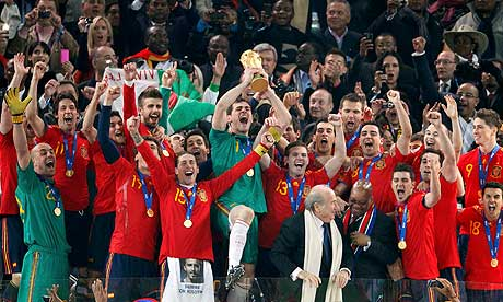 Spain with FIFA World Cup aloft. Nearly the entirety of the squad was part of a 'B/C' team