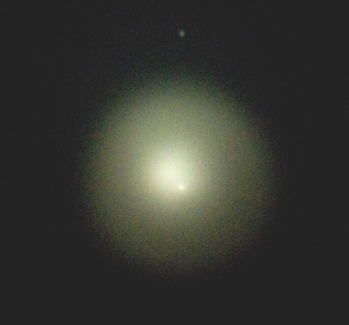 Taken afocally through a telescope eyepiece on 10/27/2007.  Comet Holmes was a surprise and became a massive object as it expanded.