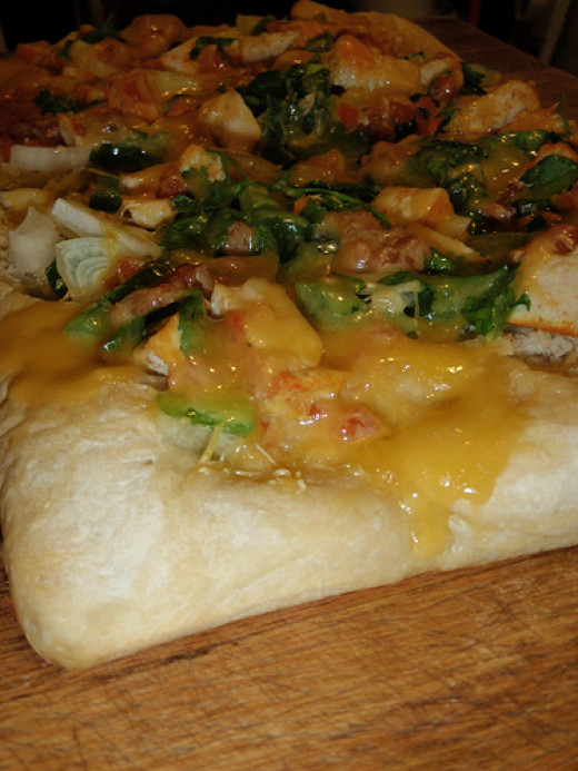 Use this bread machine recipe for home made pizza crust and load it up with your favorite toppings.