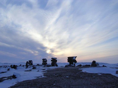 Photo: Inukshuks dot the landscape in  frozen places