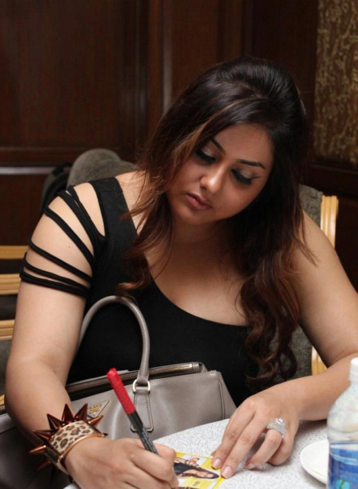Namitha signing Autograph for her fans