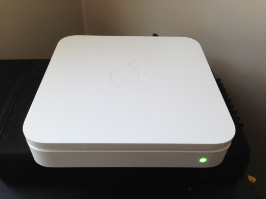 Apple Airport Extreme is small (w 61/2'' x L 6/12'' x H 11/2 ) The unit lays horizontal.