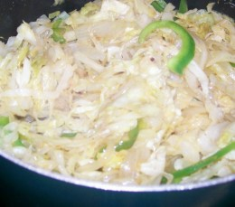 fried cabbage with onions, bell peppers & seasonings