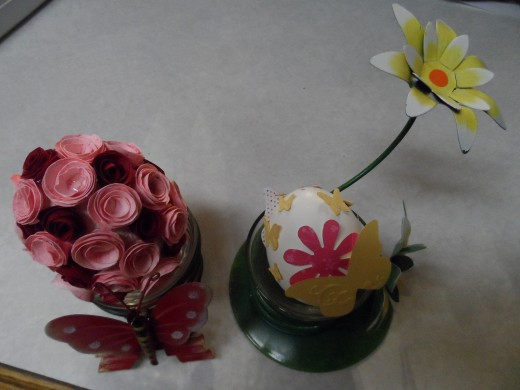 Punch art paper shapes glued on empty egg. and mini paper roses glued on styrofoam egg.