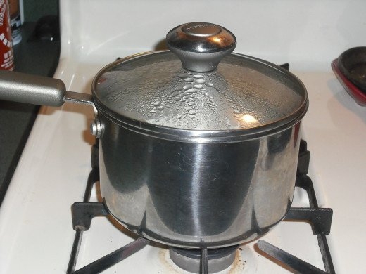 Cover and reduce heat to low; cook for 20 minutes.  After time is up, turn off heat, but leave the lid on and do not disturb the pan for at least another 10 minutes.
