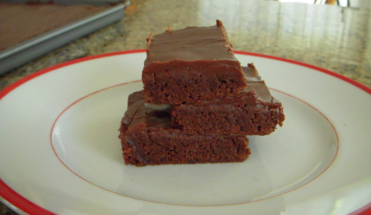 Homemade brownies with icing.