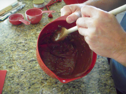 Mix icing in bowl until it is just fluid enough to pour.