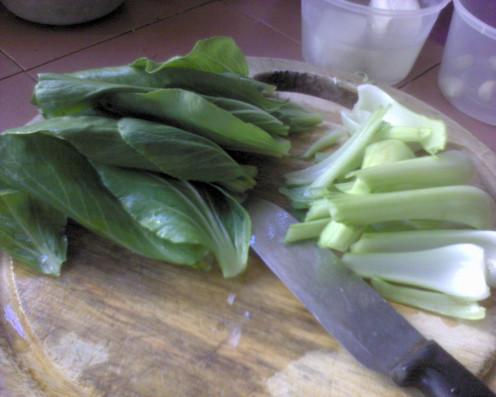 cut of the stem from the Pak Choy leaves