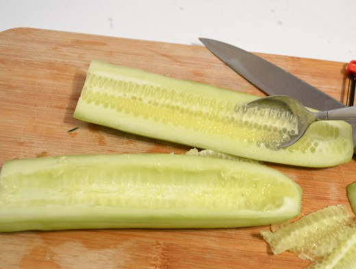 Scoop out the cucumber's seeds.