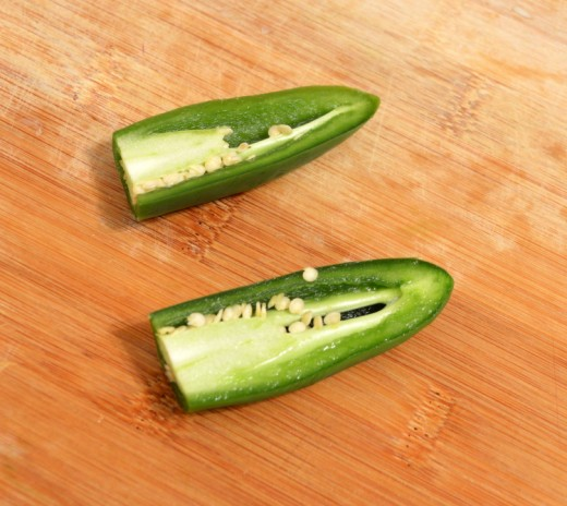 Cut open the jalapeño and clean out the seeds.