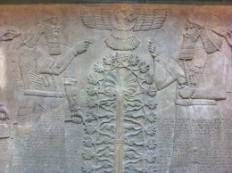 King Ashurnasirpal depicted twice around the sacred tree that represented the tree of life in Babylonian mysticism.