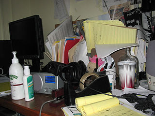 A clutter-filled (and dangerous!) desk