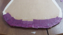 Brush over tissue paper with glue to keep paper lying flat on board.