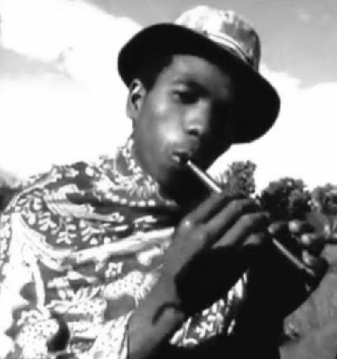 Young man plays inkos'tina (flute) - Image by Lemubarby