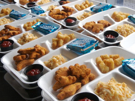 Chicken nuggets, ketchup, tater tots, some kind of cheesy looking mix and a sugar treat.  No true vegetables or fruits.  This lunch contains no fiber or antioxidants.  It brings on blood sugar spikes and is overloaded with trans fats.